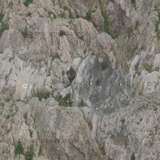 Mountain rock face with dirt and other natural textures.