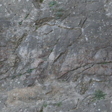 Hard stone cliff face with marble and other hard rock mixed in.